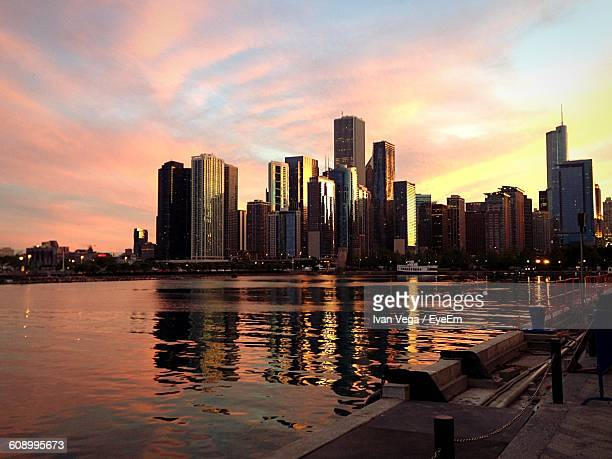 River And Buildings Against Sky At Sunset