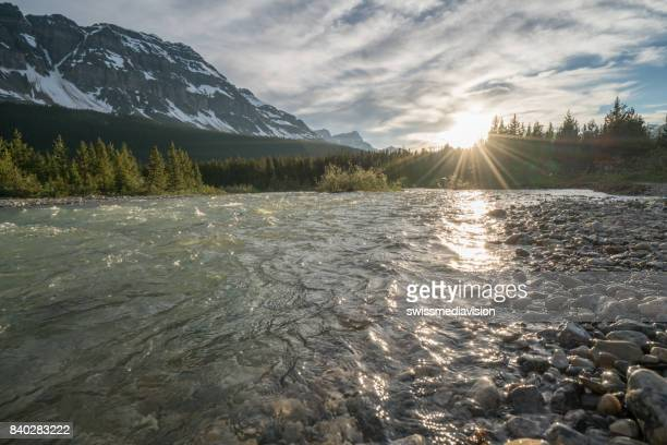 River and Canadian Rockies at sunset