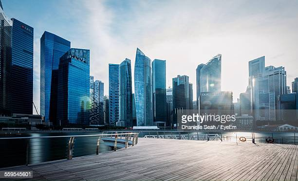 River And Modern Buildings Against Sky