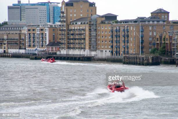 A river boat clipper is pictured on river Thames against the backdrop of the City London on July 24 2017 The skyline is always changing as the...