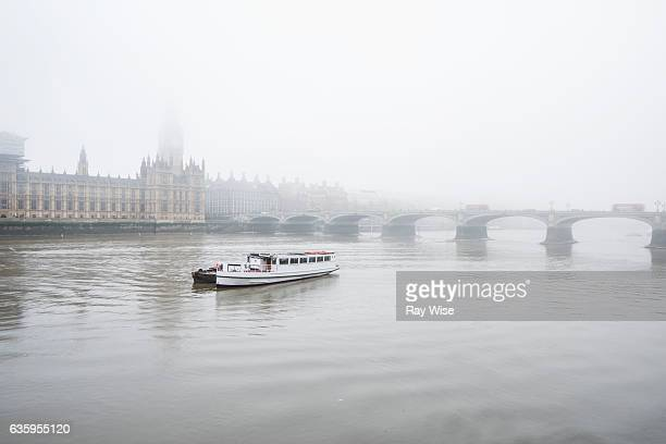 river boat on the Thames in fog.