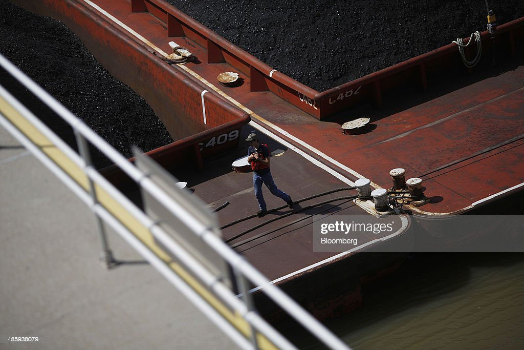 A river boat worker stands on coal barges inside US Army Corp of Engineers McAlpine Locks on the Ohio River in Louisville Kentucky US on Thursday...