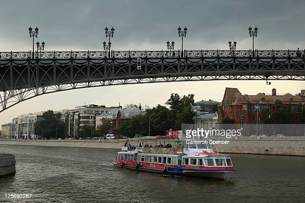 A river cruise boat heads down the Moskva River ahead of the IAAF World Championships on August 6 2013 in Moscow Russia