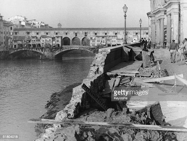 A river embankment in ruins after the Arno burst its banks in Florence 9th November 1966 In the background is the Ponte Vecchio