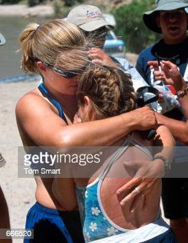 A river guide hugs a young camper and burn survivor with the University of Utah Burn Camp June 17 2000 during the last day of their expedition on the...