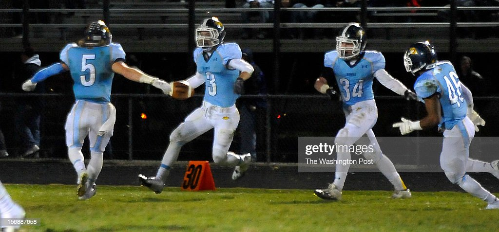 River Hill's Evan Griffin(3) celebrated after picking-off a Urbana pass late in the fourth quarter with Justin Arn(5), Brian Kirby (34) and Chris Galloway(46) on Friday, November 23, 2012 in Clarksville, Md.