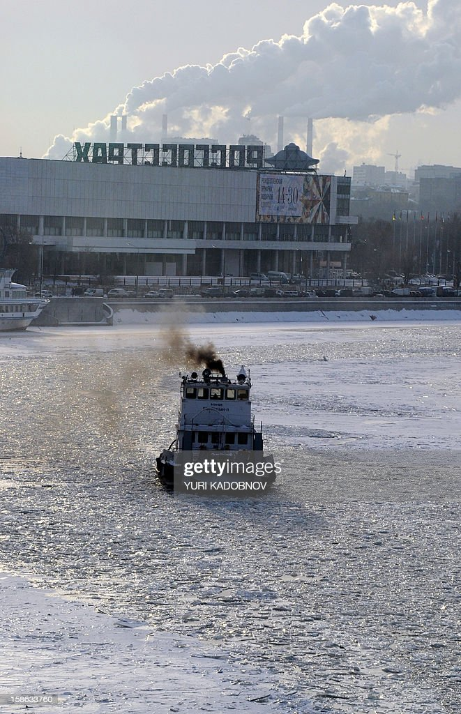 A river icebreaker breaks ice on the Moskva river, ploughing a fairway for a pleasure boat near the Kremlin in central Moscow on December 22, 2012. A cold wave of weather hit this week the Russian capital. The temperatures in Moscow reached today to -16C (3F).