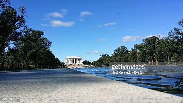 River In Front Of Lincoln Memorial Against Blue Sky
