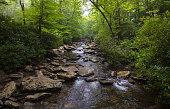 Color image of a small river flowing over river rock in the Great Smoky Mountain National Park in North Carolina.