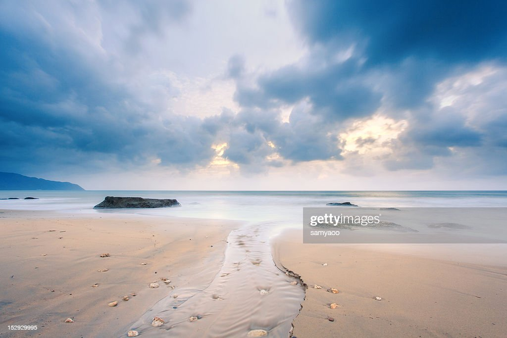 River on beach during sun rise : Stock Photo