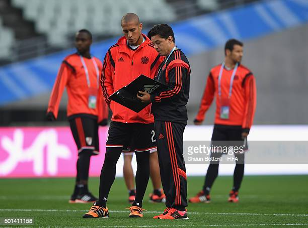 River Plate coach Marcelo Gallardo talks with player Jonatan Maidana during a training session at Osaka Nagai Stadium on December 15 2015 in Osaka...