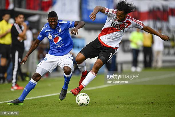 River Plate defender Arturo Mina wins the ball from Millonarios forward Dairon Estibens Asprilla Rivas during the first half of a Florida Cup...