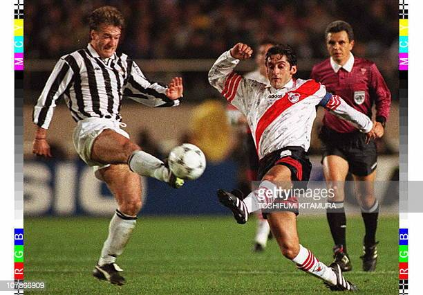 River Plate forward Enzo Francescoli battles for a ball with Juventus midfielder Didier Deschamps during the 17th Toyota European/South American Cup...
