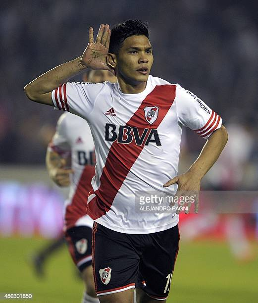 River Plate forward Teofilo Gutierrez celebrates after scoring against Lanus during their Argentine First Division football match at Lanus stadium in...