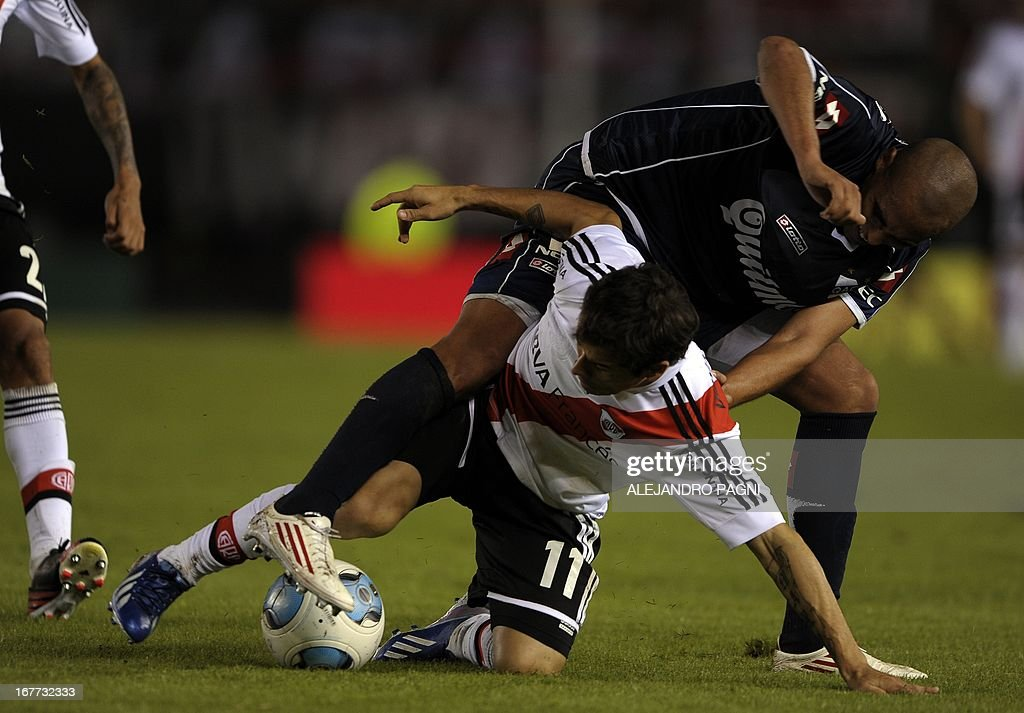 River Plate's 4forward Rodrigo Mora (bottom) vies for the ball with Quilmes' defender Sebastian Martinez during their Argentine First Division football match, at the Monumental stadium in Buenos Aires, Argentina, on April 28, 2013. AFP PHOTO / Alejandro PAGNI