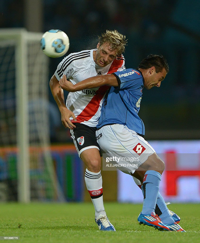 River Plate's defender Jonathan Bottinelli (L) heads the ball over Belgrano's forward Cesar Pereyra during their Argentine First Division football match, at Mario Alberto Kempes stadium in Cordoba, Argentina, on February 10, 2013.