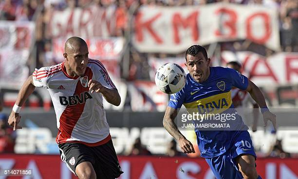 River Plate's defender Jonathan Maidana vies for the ball with Boca Juniors' forward Carlos Tevez during their Argentine first division football...
