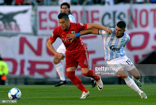 River Plate's defender Jorge Moreira vies for the ball with Atletico Tucuman's midfielder David Barbona during their Argentina First Division...