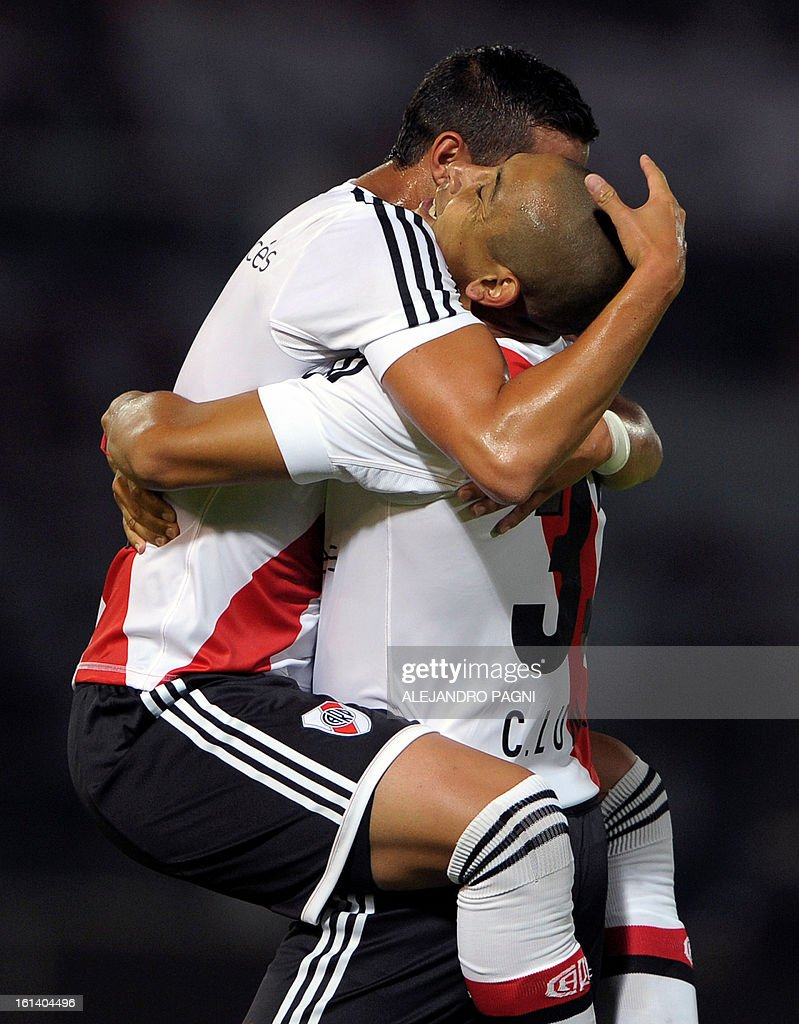 River Plate's forward Carlos Luna (R) celebrates with teammate forward Rogelio Funes Mori after scoring the team's second goal against Belgrano during their Argentine First Division football match, at Mario Alberto Kempes stadium in Cordoba, Argentina, on February 10, 2013.