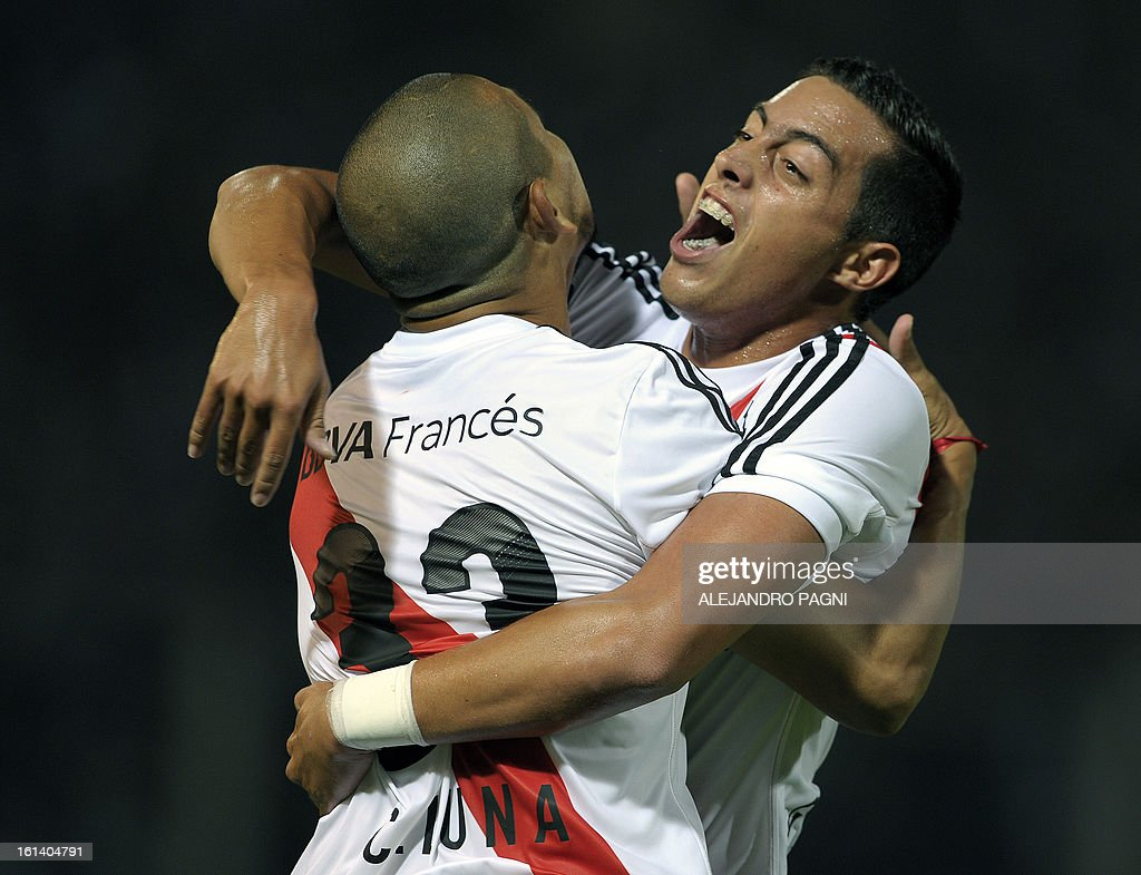 River Plate's forward Carlos Luna (L) celebrates with teammate forward Rogelio Funes Mori after scoring the team's second goal against Belgrano during their Argentine First Division football match, at Mario Alberto Kempes stadium in Cordoba, Argentina, on February 10, 2013.