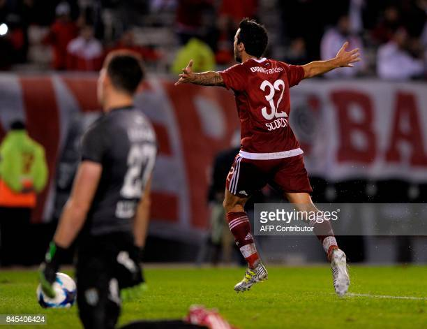 River Plate's forward Ignacio Scocco celebrates after scoring the team's third goal against Banfield during their Argentina First Division Superliga...