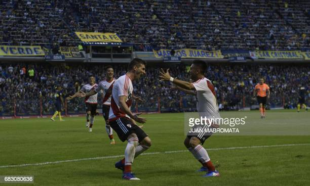 River Plate's forward Lucas Alario celebrates with teammate Gonzalo Martinez after scoring the team's second goal against Boca Juniors during their...