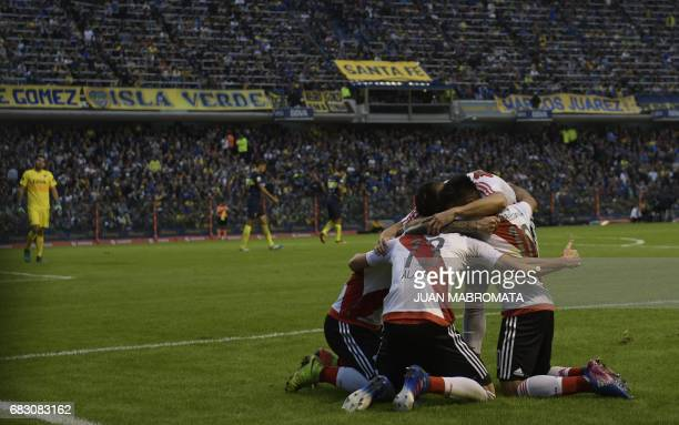 River Plate's forward Lucas Alario celebrates with teammates after scoring the team's second goal against Boca Juniors during their Argentina first...