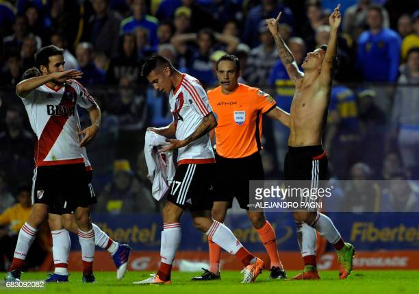 River Plate's forward Sebastian Driussi celebrates with teammates after scoring the team's third goal against Boca Juniors during the Argentina first...