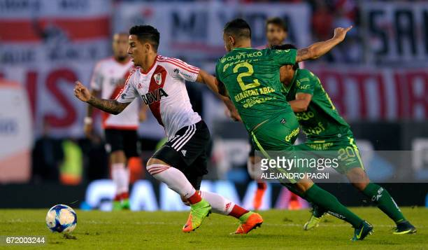 River Plate's forward Sebastian Driussi controls the ball past Sarmiento's defender Nicolas Bianchi Arce during their Argentina First Divsion...
