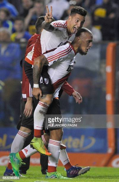 River Plate's forward Sebastian Driussi gestures after defeating Boca Juniors 31 in an Argentina first division football match at the La Bombonera...