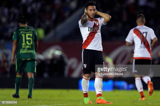 River Plate's forward Sebastian Driussi gestures after missing a chance of goal against Sarmiento during their Argentina First Divsion football match...