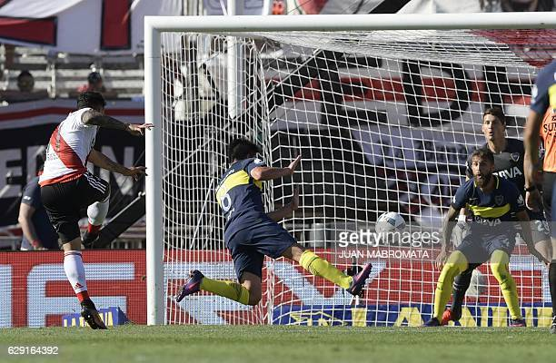 River Plate's forward Sebastian Driussi kicks to score against Boca Juniors during their Argentine first division football match at the Monumental...