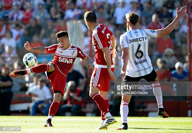 River Plate's forward Sebastian Driussi shoots the ball during their Argentina First Division football match against Estudiantes at Tomas Adolfo Duco...