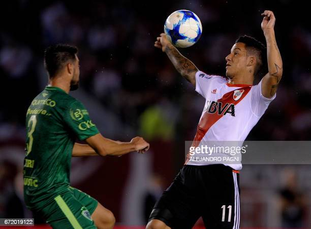 River Plate's forward Sebastian Driussi vies for the ball with Sarmiento's defender Francisco Dutari during their Argentina First Divsion football...