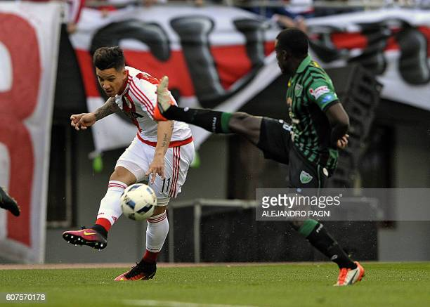 River Plate's forward Sebastian Driussi vies for the ball with San Martin's defender Mauricio Casierra during their Argentina First Division football...