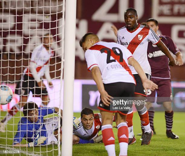 River Plate's Gabriel Mercado scores a goal against Lanus during a match between Lanus and River Plate as part of the Torneo Inicial 2013 at Nestor...
