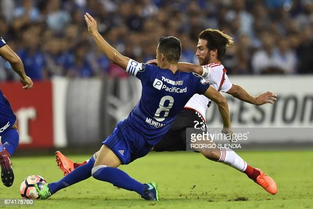 River Plate's Leonardo Ponzio vies for the ball with Emelec's Marcos Mondaini during their 2017 Copa Libertadores football match at George Capwell...