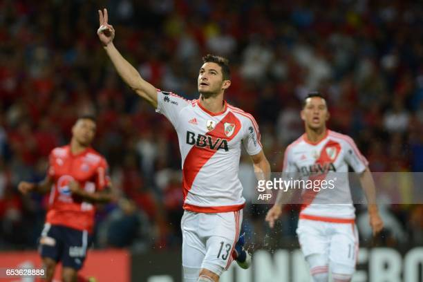 River Plate's Lucas Alario celebrates after scoring against Independiente Medellin during their Copa Libertadores 2017 football match at the Atanasio...