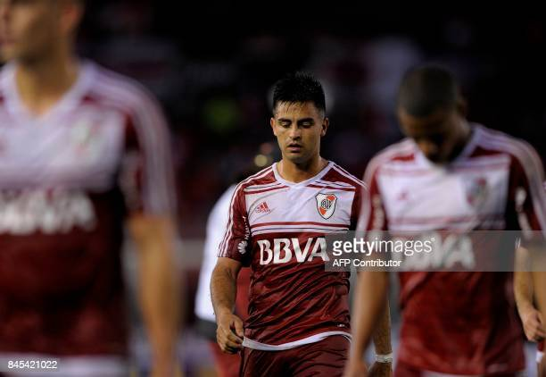 River Plate's midfielder Gonzalo Martinez and teammates leave the field at the end of the half time against Banfield during their Argentina First...