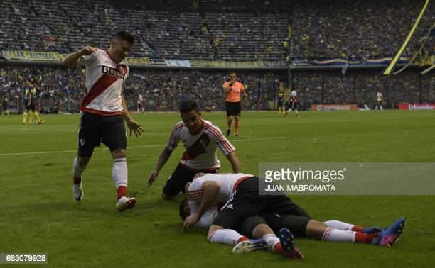 River Plate's midfielder Gonzalo Martinez celebrates with teammate Lucas Alario Sebastian Driussi and Jorge Moreira after scoring the team's first...