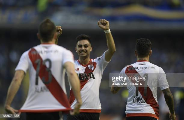 River Plate's midfielder Gonzalo Martinez celebreates after teammate forward Lucas Alario scored the team's second goal against Boca Juniors during...