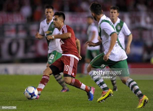River Plate's midfielder Gonzalo Martinez controls the ball during their Argentina First Division Superliga football match against Banfield at...
