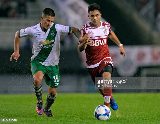 River Plate's midfielder Gonzalo Martinez vies for the ball with Banfield's midfielder Nicolas Linares during their Argentina First Division...