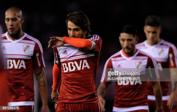 River Plate's midfielder Leonardo Ponzio and teammates leave the field at the end of the first half of their Argentina First Division football match...