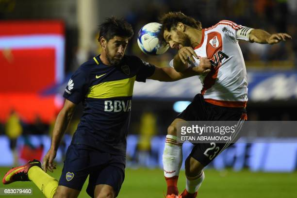 River Plate's midfielder Leonardo Ponzio vies for the ball with Boca Juniors' midfielder Pablo Perez during their Argentina first division football...