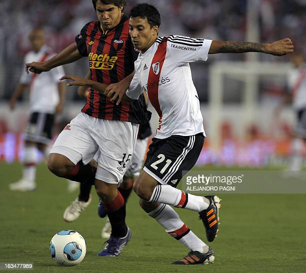 River Plate's midfielder Leonel Vangioni vies for the ball with Colon's midfielder Gabriel Graciani during their Argentine First Division football...