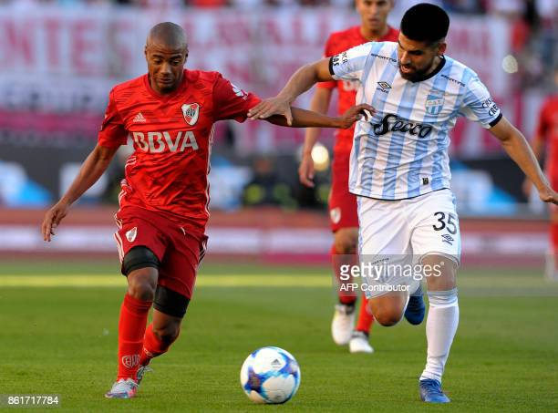 River Plate's midfielder Nicolas De la Cruz vies for the ball with Atletico Tucuman's defender Cristian Villagra during their Argentina First...