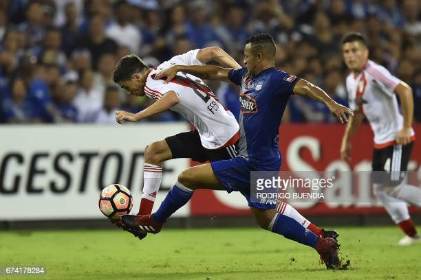 River Plate's player Ignacio Fernandez vies for the ball with Emelec's Pedro Quinonez during their 2017 Copa Libertadores football match at George...