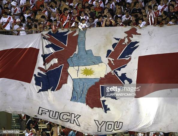 River Plate's supporters deploy a banner with the silohuette of the Falklands Islands during the Recopa Sudamericana 2015 first final football match...