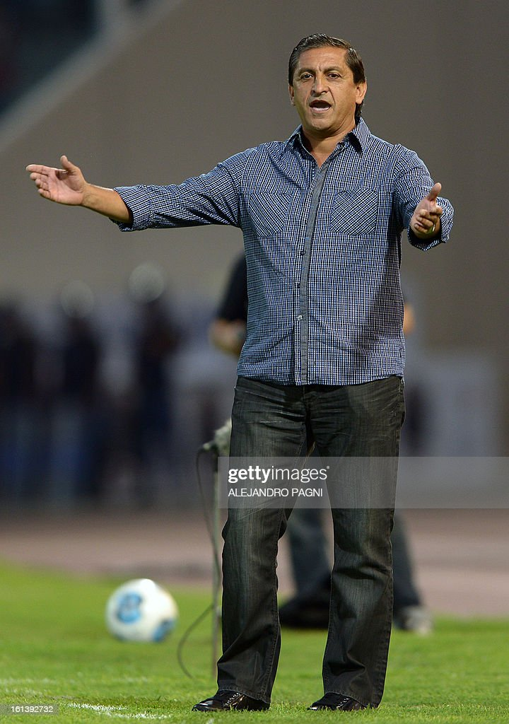 River Plate's team coach Ramon Diaz gestures during the Argentine First Division football match against Belgrano, at Mario Alberto Kempes stadium in Cordoba, Argentina, on February 10, 2013.
